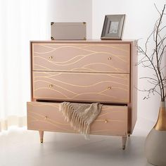 Surround yourself in the luxury of a stylish bedroom with this contemporary antique gold wave chest. Crafted with solid wood, its real gold leaf wave design and posh pink hue create a peaceful oasis. Its soft-closing drawers make it a designer favorite. Pink Dresser, Dresser As Nightstand, Find Furniture, Bedroom Furniture, Restored Dresser, White Chests, Gold Bedroom, Stylish Bedroom, Storage Spaces