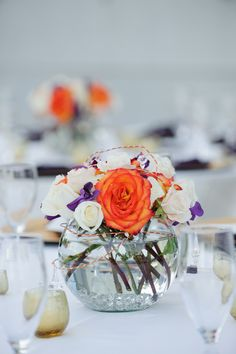 orange and white roses with purple accents ~ Carrie Wildes Photography