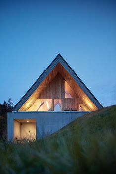 pavel míček architects' contemporary timber weekend house in beskydy recalls traditional cabin geometries in concrete and larch wood. Glass Building, Weekend House, Vernacular Architecture, Mountain Designs, Concrete Wood, Mountain Landscape, Architect Design, Modern House Design, Modern Houses