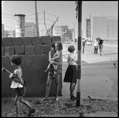 Children playing near a portion of the Berlin Wall at the time of its construction, Friedrichstrasse near Checkpoint Charlie, West Berlin, Germany, August 1961