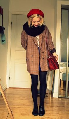 Camel brown coat jacket, black scarf, black pants, black shoes, red beret, white top, blue skirt