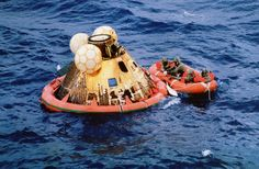 Apollo 11 crew and a Navy diver await pickup after a safe splashdown east of Wake Island in the Pacific Ocean on July 24th, 1969. (NASA) #
