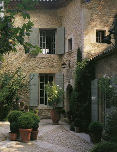 I love this color blue with the stone --I hope my next house is like this European Style Home & Courtyard Garden