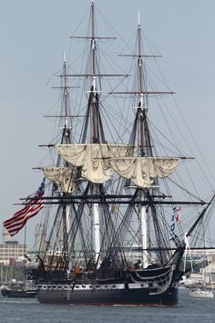 The USS Constitution is escorted by a tugboat in Boston Harbor in Boston, Sunday, Aug. 19, 2012. The USS Constitution, the U.S. Navy's oldest commissioned war ship