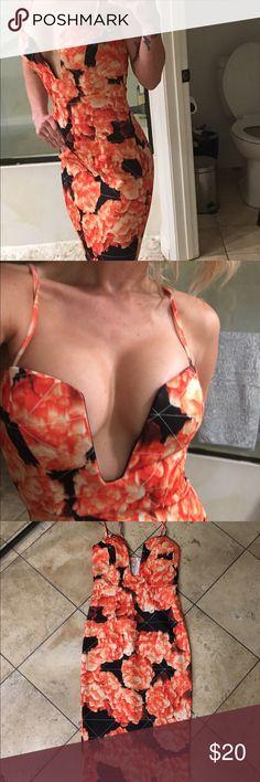 MIDI length orange and black body con dress Midi length black and orange deep V body con dress with zip up back brand blossom size 8 but fits like a S/2 Dresses Midi