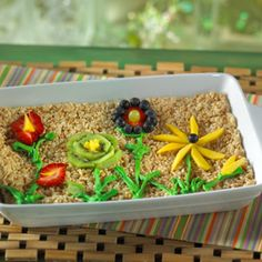 Use an array of colorful fruits to create a gorgeous garden you and your kids can munch on together.