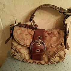 Small Coach hanbag This is an authentic Coach handbag but there is some wear on both ends and the flap; still sturdy and has some life left; price reflects wear Coach Bags