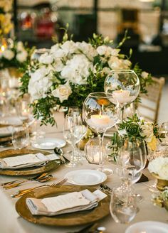 Elegant banquet tables were covered with green and white floral arrangements in varying heights all accented by classic gold.