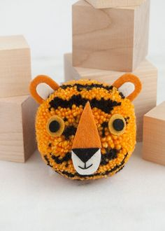 Learn how to make a DIY pom pom of the majestic tiger! Pom Pom Maker, Purl Soho, Yarn Tail, Black Felt, Needle And Thread, Embroidery Thread, Crafts For Kids, Weaving, Diy Projects