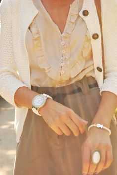 Ruffles, cardigan, and lovely jewelry.