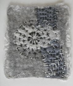 Hand embroidery on felted wool by Dutch textile artist Linda Lammerts