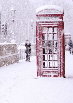 A snowy phone booth