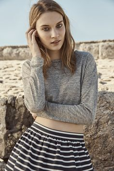Team a cropped top with a high-waisted skirt for easy style