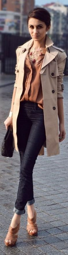 Brown blouse, statement necklace, heels and classic trench coat.