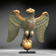 Carved and Painted Gilt Gesso and Wood Eagle Carving, America, 19th century, the spreadwing eagle perched on a ball, old green paint with so...