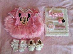 3mo Minnie Mouse Onsie w/ Matching Headband. Just pick the headband you want. Can also buy Baby Shoes or White Baby Socks. Would make a Great Baby Gift. Headbands Measure 15in Not stretched.  The doll that this outfit is on is 22in and the onsie fits loose on her.  Shoes measure 4in long