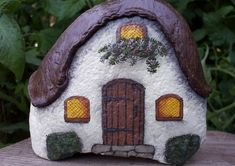 """A pinner said, """"My grandmother made rock houses like this for our garden. The perfectly shaped rock, a little paint, a little clay and voila!"""" Marie's comment: Rock houses like this would be perfect in the back yard. Pebble Painting, Pebble Art, Stone Painting, House Painting, Stone Crafts, Rock Crafts, Arts And Crafts, Art Crafts, Paper Crafts"""