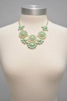 """This charming necklace will adorn your neckline with elegance!  The mint faceted stones are set in gold on an 18"""" adjustable chain."""