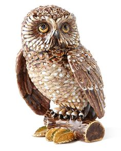 """Handcrafted owl figurine. Cast pewter. 18-kt. matte gold and medium-brown antiqued finish. Hand enameled and hand set with Swarovski crystals. 3.5""""W x 3""""D x 4.5""""T. Made in the USA."""