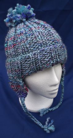 Hand knitted woolly ear flap hat with bobble in attractive 'Bayou blue'. Handknit hat. Knit hat. Wool hat. Earflap hat with braids / plaits