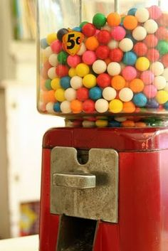 These gumball & jaw-breaker machines were common inside & outside grocery stores. I'm sure a few teeth were broken chewing the jaw-breakers!