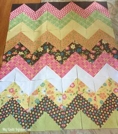 Easy Peasy Chevron Quilt Tutorial. The trick here is the streamlined way of cutting, stacking, sewing  pairs of large squares all around the edge and then cutting across both diagonals to form multiple sets of 4 half-square triangles. Keep pieces stacked in sequence to sew HST's together for each row, and then join the rows together. Tutorial shows you the nifty systematic way the quilt top goes together.