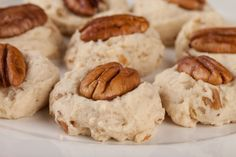 Homemade Pecan Sandies 2 cups all-purpose flour 2 sticks unsalted butter, room temperature 1 large egg, room temperature ½ cup granulated sugar 2 teaspoons vanilla extract 1 teaspoon salt 1 teaspoon baking soda 2 cups pecans- 1 cup chopped, 1 cup reserved whole for optional decoration