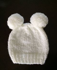 Double Pom Pom Beanies. The sweetest knit hat. Double Pom Poms make this hat super sweet for all ages. Knit band along the bottom keeps it securely on. Made with a super soft yarn that is warm but still lightweight - Sizes : 0-3 months 14- 15 circumference 3-6 months 15 - 16