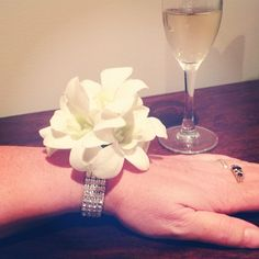 @theflowergirlperth's photo simple wrist corsage with white orchids and bling for wedding or school ball
