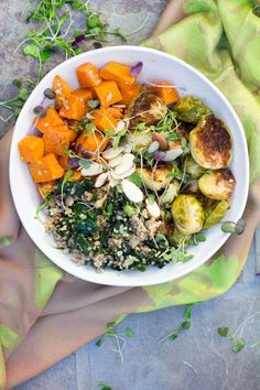 """A """"Buddha Bowl"""" is the ultimate satisfying nutritious meal, a bountiful bowl of beautiful, healthy, vegetarian ingredients. This sweet potato brussels sprout buddha bowl combines roasted vegetables kale, quinoa, and a luscious lemony dressing. Plus, it's"""