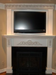 Dress up the tv by continuing the trim above the mantle and around the tv.