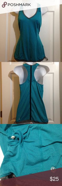 """LULULEMON size 6 Teal, Gray Racerback Tank Top LULULEMON size 6 Teal green and Gray Racerback Tank Top. Pre-owned in EXCELLENT condition. This has the drawstring bottom hem. Measurements are taken laying flat. U to U 16"""" Shoulder to Hem 27"""" Width at Bottom Hem 18.5"""". There is a faint gray horizontal stripe throughout, can be see in pic 3. lululemon athletica Tops Tank Tops"""