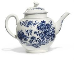 A WORCESTER BLUE AND WHITE GLOBULAR TEAPOT AND COVER CIRCA 1775, BLUE CRESCENT MARK Printed with the 'Fence' pattern, concentric band borders, the cover with flower finial 5½ in. (14 cm.) high (2) Christies lot351