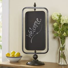 null With a charming swivel feature and ornate pedestal stand, this tabletop chalkboard is just the thing to display dinner menus and more. Chalkboard Table, Chalkboard Signs, Tabletop, Kitchen Nightmares, Calendar Board, Fun Snacks For Kids, Table Signs, Shop Front Design, Blackboards
