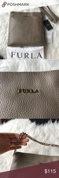 "NWT Furla Julia Chain small leather crossbody bag Brand new with tag. - Adjustable shoulder strap - Zip top closure - Interior features 1 zip wall pocket and 1 slip pocket - Dust bag included - Approx. 10"" H x 9.5"" W x 1.5"" D - Approx. 21-23"" strap drop Materials Leather exterior, textile lining Furla Bags Crossbody Bags"