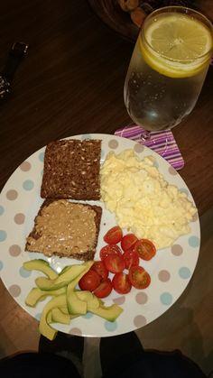 Scramble eggs (1yolk,3egg whites) Cherry tomato's , avocado , rye bread and peanut butter