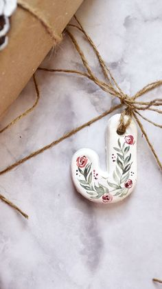 Pine branches painted with watercolor by Sam Allen Creates. Scandinavian Christmas Decorations, Family Christmas Ornaments, Christmas Art, Letter Ornaments, Clay Ornaments, Craft Gifts, Diy Gifts, Polymer Clay Crafts, Diy Clay