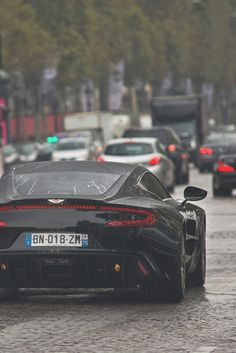 Black Aston Martin, a luxury elegant car | Find more inspirations and ideas in http://www.bocadolobo.com/en/inspiration-and-ideas/
