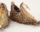 fairy slippers. I need to make some and leave them for these wee folk. I bet they are cold up here with out shoes. he he