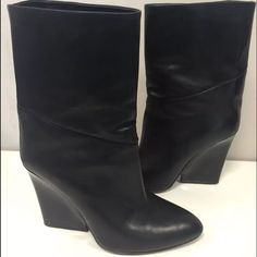"Authentic Jimmy Choo Wedge Booties Size 39 Authentic and beautiful black leather Jimmy  Choo wedge ankle booties! These are pre owned but in good condition. There are a few minor scratches on the leather but nothing noticeable unless looking closely. Extremely comfortable 4"" wedge in a contrasting black patent. Made in Italy. These are great for a night out or dressed down with a chunky sweater. Retailed for $995 but get them here for so much less!! Jimmy Choo Shoes Ankle Boots & Booties"