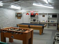 game room with pool table in garage