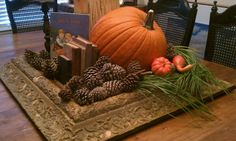 Harvest Table Centerpiece with old frame  http://farmhouseporch.blogspot.com/2011/11/natural-christmas.html