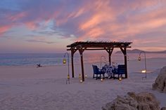 A private dinner on the beach at sunset by La Ventanas al Paraiso Resort in Los Cabos, Mexico. -
