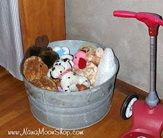 Galvanized Tub Toy Storage.... I have one of these tubs in the garage collecting dust, might put it to use!