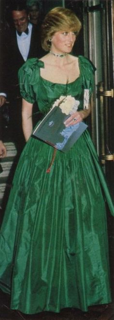 Princess Diana wore an Art Deco emerald and diamond choker when she attended charity concert in Barbican, November 1982. She wears a green gown by Graham Wren.
