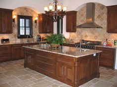 Beautiful Kitchen with Granite Countertops and Eased Edge with Tumbled Travertine Backsplash and Travertine Floor.