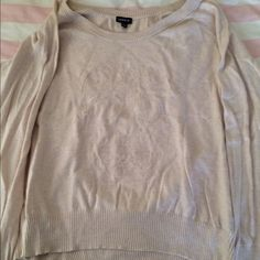 Sugar skull sweater This is s beautiful cream color sweater with a sugar skull embroidered on the front. It's been loved but well taken care or. The main areas of wear are near the armpits but it's slight. If you have any questions feel free to ask or make an offer  torrid Sweaters Crew & Scoop Necks