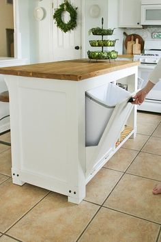 DIY Kitchen Island with Built in Trash Storage ~ Have you always wanted a kitchen island but never had a idea to go from? well this is a great DIY project for a amazing Kitchen island with built in trash storage. A kitchen island does helps so mush if you are struggling for space in your kitchen.