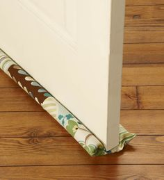 DIY Door Draft Stopper...we could definitely use a number of these!!