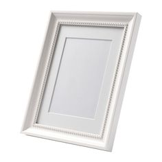 "Ikea ""SÖNDRUM""  Frame, white  $3.99  The mat enhances the picture and makes framing easy.  For the awesome photos dad gave us for Christmas."